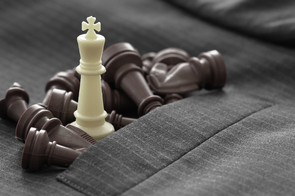 close up of chess figure on suit background strategy or leadership concept